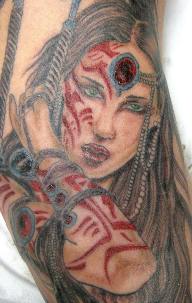 Warrior tattoo of girl with red signs on body for Native american warrior tattoos