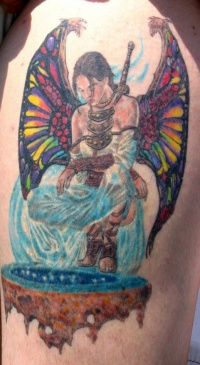 Colorful female angel warrior tattoo