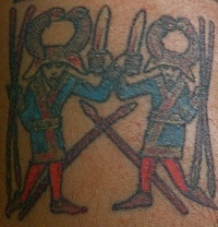 egyptian style tattoo with two warriors