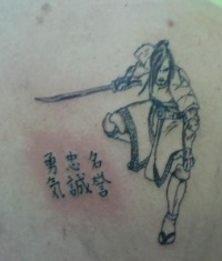 black japanese warrior tattoo with characters