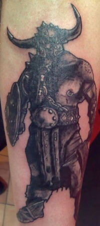 Potent warrior tattoo with shield and axe