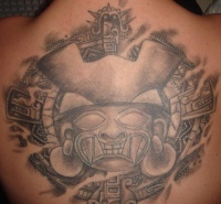 Black warrior head tattoo on the back