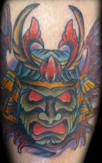 Colored japanese warrior mask tattoo